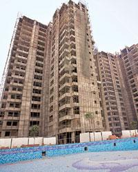 Slowing down: An under construction residential complex in Gurgaon. Housing markets in the New Delhi area and the southern Chinese cities of Guangzhou and Shenzhen dropped as much as 25% in the last y