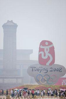 Worrying sight: Haze fills the sky outside a temporary monument to the Beijing Olympics at Tiananmen Square in Beijing on Monday. (Photograph by Bernardo De Niz / Bloomberg)