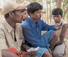 Pilot programmes: Tribals in a Uttar Pradesh village use a mobile phone. (Photograph by Harikrishna Katragadda / MINT)
