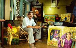 Branching out: Artist Mustajab Ahmed Siddiqui 'Shelle' with his oil paintings at his studio in Amroha, UP. Having painted Hindi pocket book covers for more than 30 years, Shelle hopes to exhibit his w