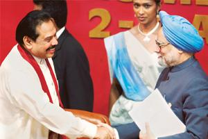Strenghtening ties: Sri Lankan President Mahinda Rajapaksa (left) greets Prime Minister Manmohan Singh at the closing ceremony of the Saarc summit in Colombo on 3 August. Singh has impressed upon Raja