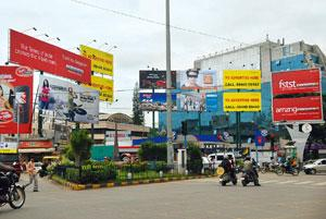 Playing field: Billboards for DNA, The Times of India and Deccan Chronicle newspapers compete for eyeballs in Bangalore, whose growing ranks of young and urban professionals are appealing to advertise