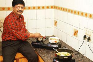 Fuel saver: RealTime Systems MD P. Rajasekhar using an I-Stove. The induction cooker is emerging as an eco-friendly alternative to gas stoves. Photograph: RA Chandru / Mint