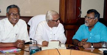 West Bengal Chief Minister Buddhadeb Bhattacharjee at a meeting with Leader of the Opposition Partha Chatterjee to discuss the Singur crisis in Kolkata on Wednesday. Photograph: Ashok Bhaumik / PTI