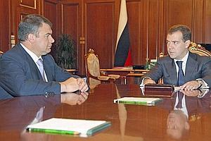 Russian President Dmitry Medvedev with Defence Minister Anatoly Serdyukov, left, during a meeting at the Kremlin on 12 August.  Post-withdrawal, Russian peacekeeping soldiers will remain in a security