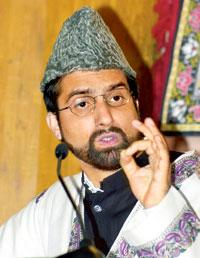 Making a point: A file photo of Mirwaiz Umer Farooq. Photograph: Sajjad Hussain/AFP