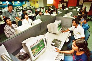 Market concerns: A file photo of the Global Business Park call centre in Gurgaon. The proposed move in some US states to restrict companies from offshoring their services could mean less business for