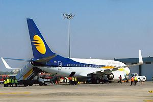 Realigning plans: A Jet Airways plane at Mumbai airport. Jet will realign its domestic network in line with its international flights to reduce waiting time for passengers from smaller cities on conne