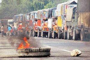 Eye of the storm: Trucks stranded on a highway at Purani Mandi in Jammu last Tuesday, during a protest sparked by the dispute over a piece of land near the Amarnath shrine. Photo: PTI