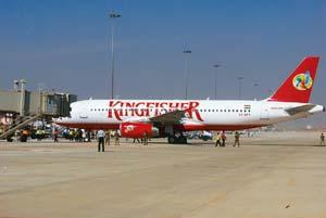 Wait and watch: A Kingfisher airline plane at Bangalore airport. Domestic carriers say they are in no position to immediately pass on the benefit of lower fuel prices to consumers. (Hemant Mishra/Mint