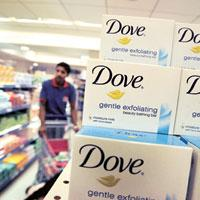 Moving forward:Hindustan Unilever's Dove soaps in a Mumbai store. With consumers spending more on premium products such as body washes and shower gels, the segment has caught the eye of big players. A