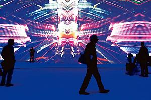 Dazzling display: Visitors watch a 29 August video presentation by Sony at the IFA consumer electronics fair in Berlin. Sony showed off its new products, including the ZX1, the thinnest LCD TV in the