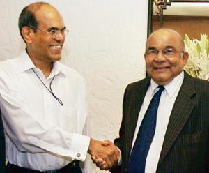 Passing the baton: Newly appointed RBI governor D. Subbarao (left) being congratulated by his predecessor Y.V. Reddy at a function in New Delhi on Wednesday. Lakshman Iyer / PTI