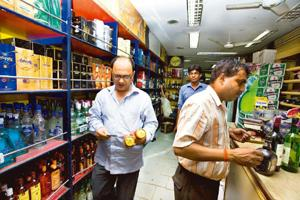 Sale push: A liquor shop in New Delhi's Connaught Place. Imported spirits make up for 1.25 million cases consumed in India every year. Rajeev Dabral / Mint