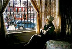 Lonely vigil: Constrained by an unfamiliar language and the violence of New York's immigrant neighbourhoods, Tara Singh sits in the window of his son's home in Queens. A retired sergeant major of the