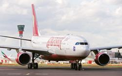 Fuel pinch: A Kingfisher Airlines' A330 aircraft at London's Heathrow Airport on 3 September. The company, which started international operations on the same day, says it will still fly non-stop to US