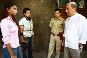 New take: A still from the movie A Wednesday, a Rs3.5 crore budget film about the story of a policeman's efforts to thwart a series of bombings. Its cast includes Anupam Kher and Naseeruddin Shah.