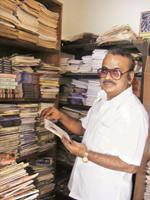 Lurid craft: Tamil pulp fiction author Rajesh Kumar with a collection of his published works at his house in Coimbatore. Samanth Subramanian/Mint