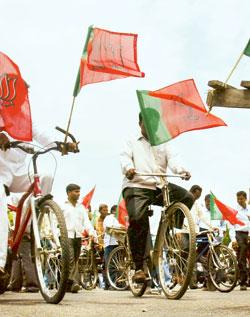 Pedal power: A file photo of activists at a BJP rally. Political parties have begun to distribute bicycles for free to pull in votes. AFP