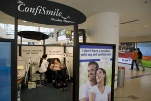 The ConfiSmile booth at the Select Citywalk mall is promoting an 'oral hygiene spa