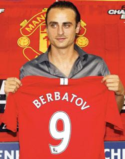 Red September: Manchester United's latest recruit Dimitar Berbatov shows off his new team jersey to the press earlier this month. Dimitar Dilkoff / AFP