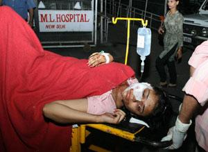 An injured being taken for treatment at RML hospital after serial blasts in New Delhi on Saturday. PTI