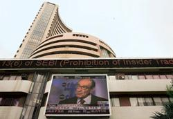 Looking for cues: Former US Fed chairman Alan Greenspan's interview being telecast on a screen on the BSE building in Mumbai on Monday. Punit Paranjpe/Reuters