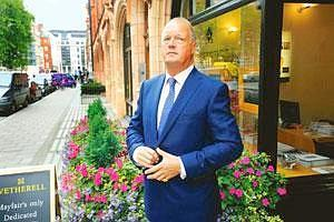 Fading emblem: Peter Wetherell, a real estate agent in the Mayfair district of London, where many of alignBritain's hedge fund managers live. The global credit crisis has punished all manner of hedge