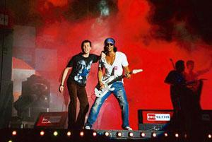 Engaging viewers: Luke Kenny (left) and Arjun Rampal, part of the fictitious band Magik from the film Rock On!!, at a concert organized by Excel Entertainment, that produced the film, in the Capital o