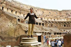 Strike a pose: Bajpai plays statue at the Colosseum; (left) Hepburn and Peck in Roman Holiday. Courtesy Shruti Bajpai