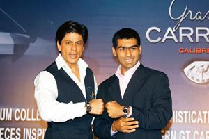 Join the club: Shah Rukh Khan and Karun Chandhok at a TAG Heuer event. Khan welcomed Chandhok aboard as a 'friend of TAG'.