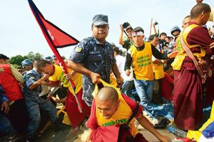 Clampdown: A file photo of police arresting Tibetans protesting against the Beijing Olympics, in Kathmandu. Deepa Shrestha / Reuters