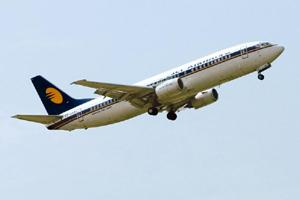 Ground clearance: A Jet Airways plane in flight. High fuel rates and low ticket prices have wreaked havoc with the financials of Indian airlines that together suffered losses of $2 billion in 2007-08.