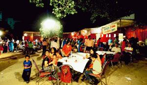 Big helpings: Stalls outside the pandal at B-block, CR Park, New Delhi. Ramesh Pathania / Mint