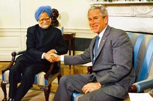 Energizing ties: US President George W. Bush, right, greets Prime Minister Manmohan Singh during their meeting in the Oval Office at the White House, on 25 September in Washington. AP