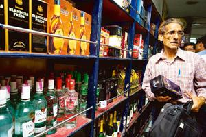 Worrying signs: A liquor shop in New Delhi. Distillers do not expect prices to come down as the production of molasses in the new sugar season commencing from November is expected to be at least 10% l
