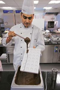 Temper the liquid chocolate for shine and shelf life. Abhijit Bhatlekar / Mint