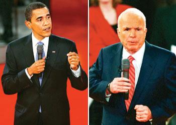 Standing tall: US Democratic presidential nominee Barack Obama (left) and his Republican counterpart   John McCain field questions during the 7 October townhall-type debate at Belmont University,Tenne