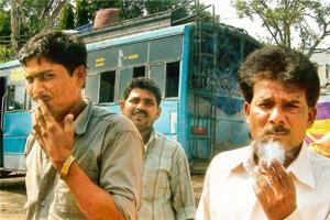 Defiant stance: A 2 October picture of men smoking at a bus stand in Bhopal flouting the Union government ban on smoking in public places. PTI