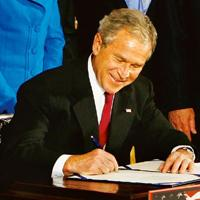 On paper: US President George W. Bush signs the US-India agreement on civil nuclear cooperation at the White House in Washington on Wednesday. Pablo Martinez Monsivais / AP