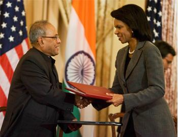 Wait ends: Secretary of State Condoleezza Rice and Foreign Minister Pranab Mukherjee, shake hands after signing the US-India Agreement for Cooperation Concerning Peaceful Uses of Nuclear Energy, durin