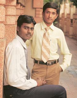 The first job: Roommates Shanmukha Bangaru (seated) and Nalla Shekhar in Hyderabad. Both hail from a tribal district in eastern Andhra Pradesh and now hold sales jobs in Hyderabad. Shashi Kiran / Mint