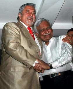 Kingfisher Chairman Vijay Mallya and his JetAirways counterpart Naresh Goyal shake hands after announcing their alliance in Mumbai on Monday. Santosh Hirlekar  / PTI Photo