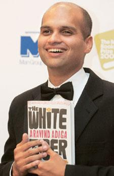 Write stuff: <b>Aravind Adiga</b> after receiving the Booker prize. AP - 6500c682-ad40-42e4-957c-213cb0cae1e7