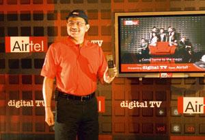 Joining hands: Bharti Airtel's CEO and joint managing director Manoj Kohli at the launch of Airtel Digital TV-- its DTH service. Ramesh Pathania / Mint