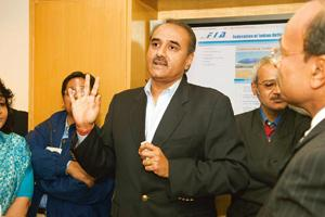 Plane speaking: A file photo of Praful Patel. The government has committed to the developers that no other airport will come up within a radius of 150km of the new airports in Hyderabad and Bangalore.