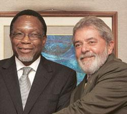 Joining hands: South African President Kgalema Motlanthe (left) and Brazilian President Luiz Inacio Lula da Silva at the third annual India-Brazil-South Africa conference in New Delhi on Wednesday. Pe