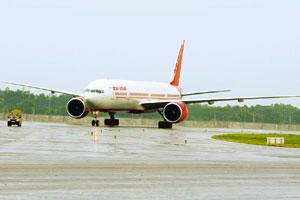 Streamlining operations: An Air India plane at India Gandhi International Airport, New Delhi. Nacil, which operates Air India, expects international revenue to expand 3-4%, or up to Rs400 crore, in a