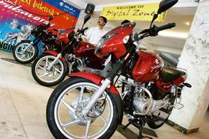 Segment focus: Bajaj motorcycles on display at a showroom in Mumbai. The company said it will launch in fiscal 2009 two new bikes in the 125cc-plus segment, which accounts for 36% of the motorcycle ma