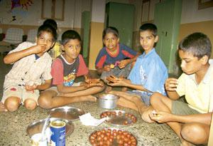 Sweet treat: Even though the boys loved these laddus, they saved some to share with friends. Niloufer Venkatraman